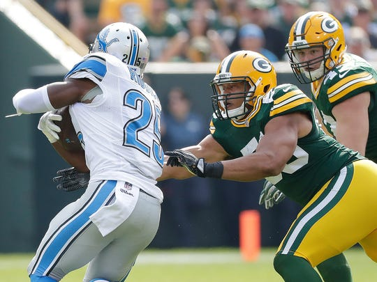 Green Bay Packers outside linebacker Nick Perry tackles Detroit Lions running back Theo Riddick at Lambeau Field. Perry had a solid performance for the Packers' defense Sunday.