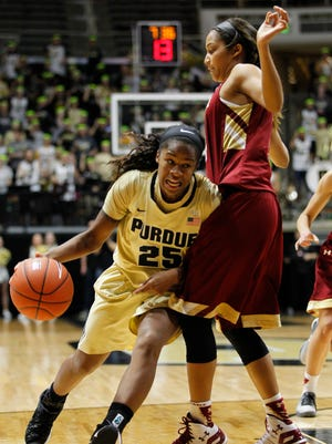 April Wilson drives against Kailey Edwards of Boston College Thursday, December 3, 2015, at Mackey Arena. Boston College nipped Purdue 58-56.