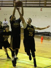 Daniella Martinez, right, tries to grab a rebound during practice Friday. The Alamogordo girls basketball team tips off the season Tuesday at Ruidoso.