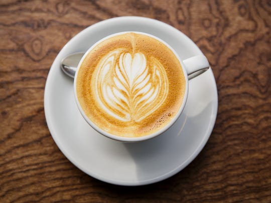 A warm drink, such as a cafe latte, can help build the hygge in winter.