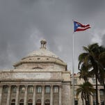 In this April 30, 2015, file photo, Puerto Rico Gov. Alejandro Garcia Padilla delivers his budget address for the next fiscal year at the Capitol building in San Juan. Puerto Rico's government says it can't make a debt payment due Saturday.