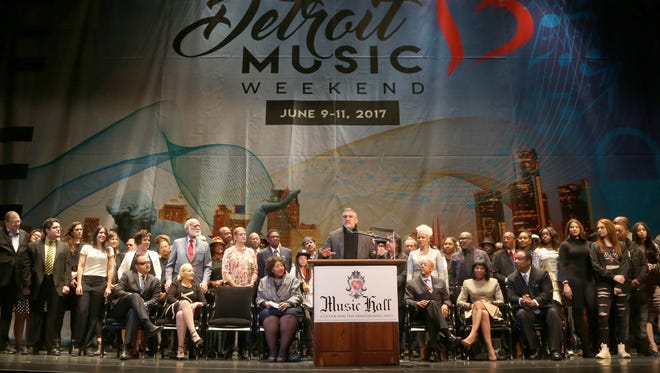 Music Hall director Vince Paul is joined by Detroit City Council President Brenda Jones, seated center left, on May 4, 2017, to announce Detroit Music Weekend, a new summer festival in the city's theater district.