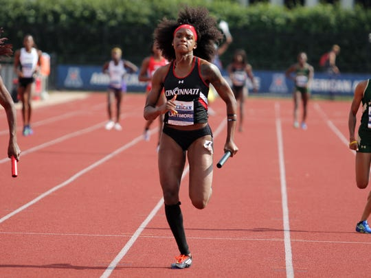 University of Cincinnati sprinter Tiona Lattimore, shown as a freshman, helped the Bearcats win their second straight American Athletic Conference women's track title this past weekend in Houston.