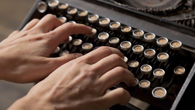 Human hand prints on retro typewriter.