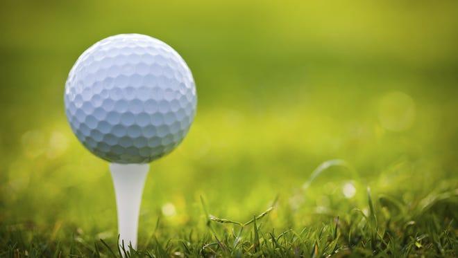 Stock photo: Golf ball on tee