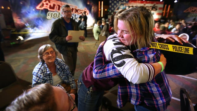 "Lisa Byrd (right) gets a hug from family members as her number comes up to perform after waiting with other would-be stars to audition for ""America's Got Talent"" at the Cook Convention Center. The reality show ran an open casting call in Memphis as the ninth stop on a 10-city tour."