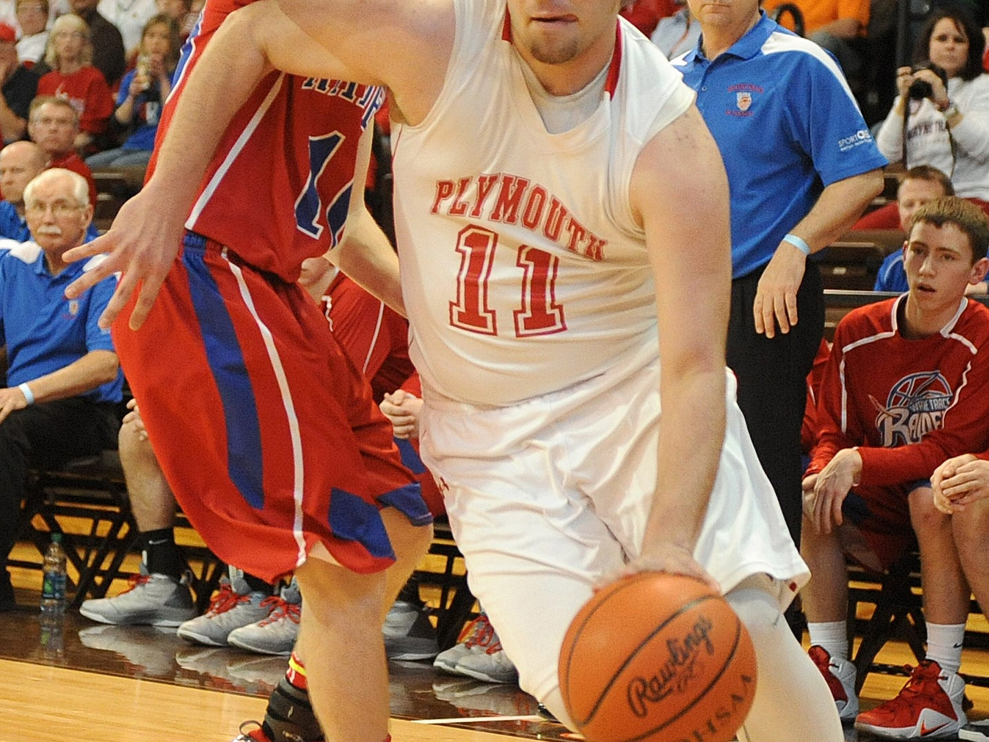 Plymouth's Tyson Beebe drives to the basket against Wayne Trace in a Division IV regional semifinal game at Bowling Green State University. The Big Red Vikings won the Firelands Conference and were the only Mansfield-area squad to advance to the Sweet 16 this year.
