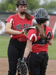 Pulaski pitcher Liz Pautz and catcher Mallory Ruechel talk between batters during a WIAA Division 1 state quarterfinal game last year. Both players earned all-Fox River Classic Conference recognition for the Red Raiders last year.