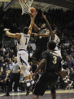 Jan 21, 2014; Evanston, IL, USA; Purdue Boilermakers guard Terone Johnson(10) shoots over Northwestern Wildcats guard/forward Drew Crawford (1) during the first half at Welsh-Ryan Arena. Mandatory Credit: David Banks-USA TODAY Sports