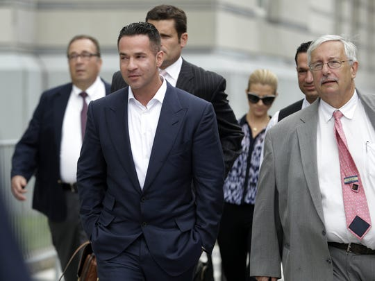 "Michael ""The Situation"" Sorrentino (left) walks with his lawyer Richard Sapinski (right)  after a  2014 court appearance. Sapinski has since withdrawn from the tax fraud case against Sorrentino."