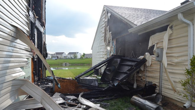 A lightning strike May 11, 2014, was believed to have caused a Far Eastside fire that scorched two homes. There were no injuries, the Indianapolis Fire Department reported.
