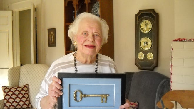 In this Dec 29, 2009, file photo, Anne Benson holds the key to Morris Plains given to her by Mayor Frank Druetzler.