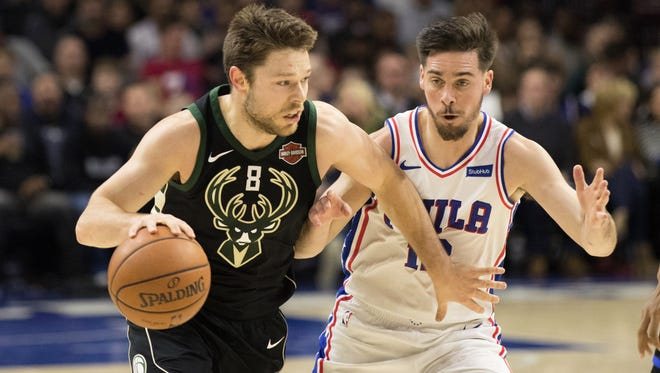 Bucks guard Matthew Dellavedova tries to get past Philadelphia's T.J. McConnell.