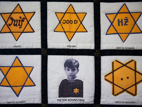 A quilt displays a childhood photo of Holocaust survivor