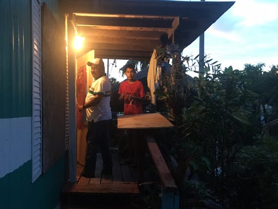 Marco Sanchez  boards up his trailer home at the Palm