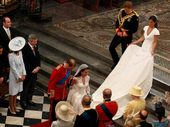 Prince William bows and his bride Catherine Duchess