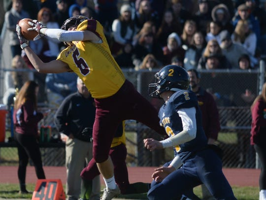 Gloucester Catholic's Matt Gray (6) makes a catch against