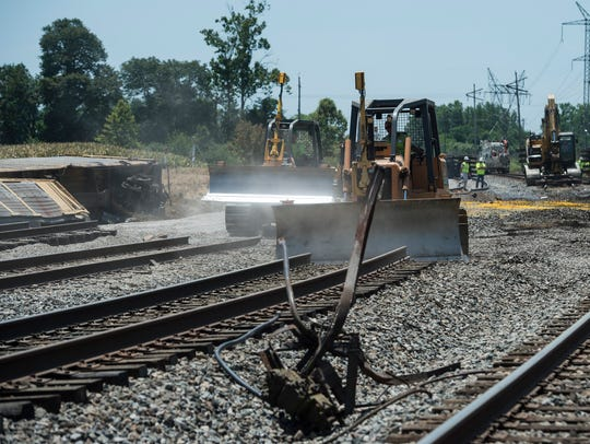 Crews clean up after a train derailed south of Alabama