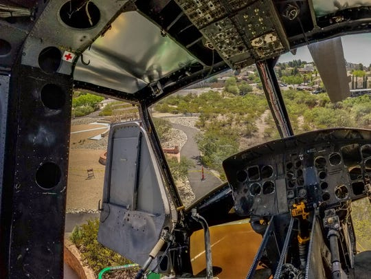 A panoramic photo shows the inside of the UH-1 Iroquois
