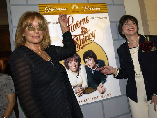 Actors Penny Marshall and Cindy Williams pose at a reception after a ceremony honoring each of them with a star on the Hollywood Walk of Fame on August 12, 2004 in Hollywood, California.