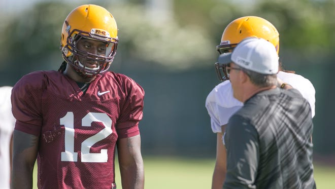 ASU head coach Todd Graham instructs tightend De'Marieya Nelson during practice at Kajikawa Practice Fields in Tempe on Friday, August 3, 2014.