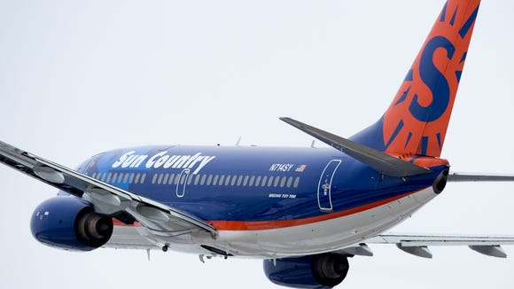 Sun Country's current livery is seen here on a Boeing