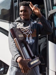 Loyola Ramblers guard Donte Ingram waves to fans after