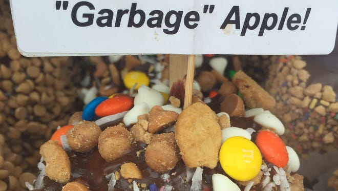 "The Rochester ""Garbage"" Apple is a candy apple covered in a variety of treats. It can be found at this year's Lilac Festival."