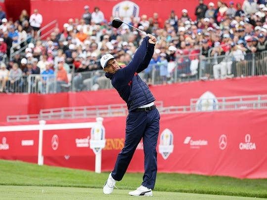 Surfer Kelly Slater of Cocoa Beach hits off the first tee during the 2016 Ryder Cup Celebrity Matches at Hazeltine National Golf Club on Sept. 27, 2016 in Chaska, Minn.