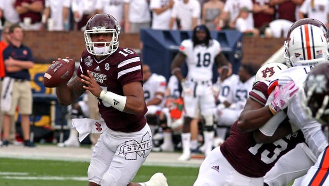 Dak Prescott has led Mississippi State atop the college football world. Can he and the Bulldogs stay there is the question.