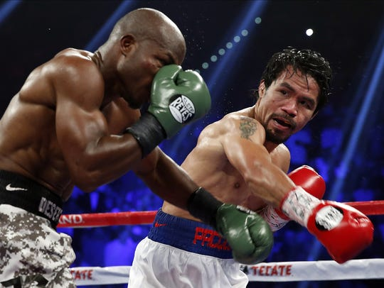 Isaac Brekken/AP file Manny Pacquiao, right, of the