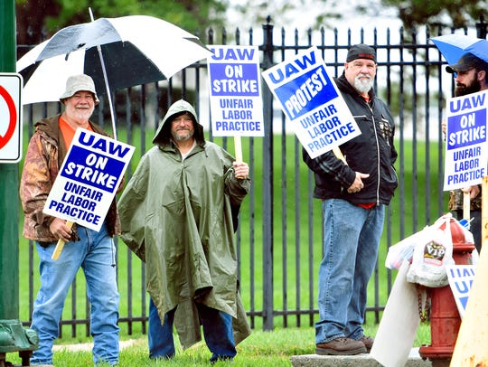 In hope of gaining a new contract, union employees,