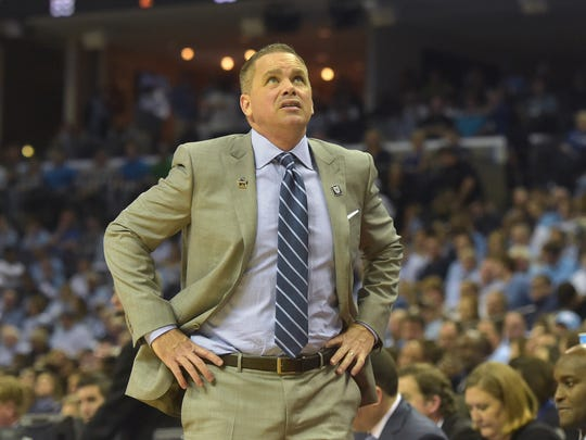Butler Bulldogs head coach Chris Holtmann reacts in the second half against the North Carolina Tar Heels during the semifinals of the South Regional of the 2017 NCAA Tournament at FedExForum. North Carolina won 92-80.