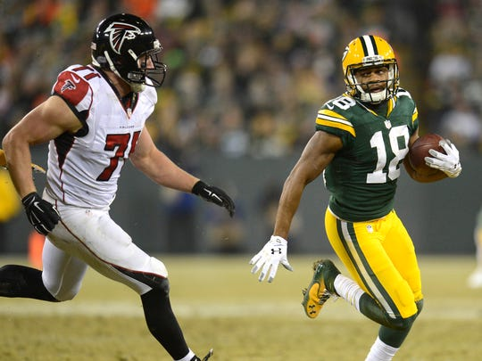 Green Bay Packers receiver Randall Cobb (18) tries to outrun Kroy Biermann (71) against the Atlanta Falcons during Monday night's game at Lambeau Field.  Evan Siegle/P-G Media