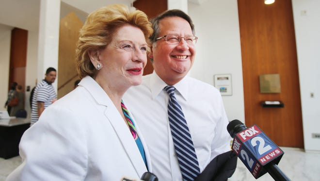 U.S. Sens. Debbie Stabenow and Gary Peters,  in 2014 at Wayne State University in Detroit, say they are pushing for help for residents affected by the Flint water crisis.