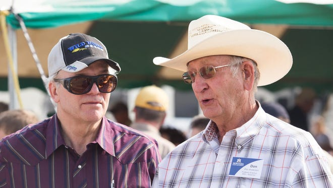 Montana State University professor emeritus Don Anderson, right, talks with his friend Tom Welch at the Northern Agriculture Research Center's 100-year celebration at Fort Assiniboine on Wednesday.