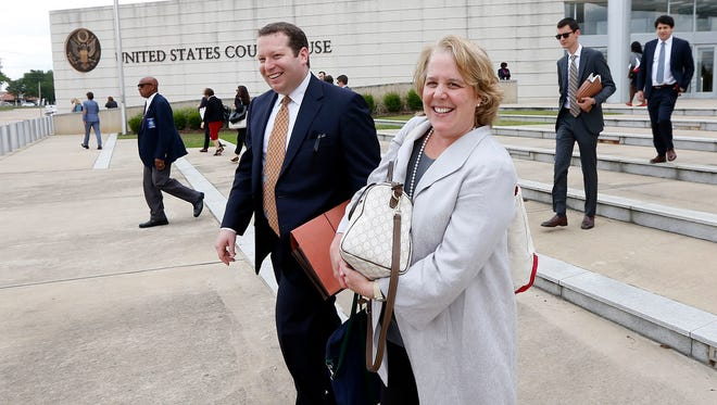 Roberta Kaplan, a New York based attorney, representing Campaign for Southern Equality and a lesbian couple, and a member of her legal team, leave the federal courthouse in Jackson, Miss., Thursday, June 23, 2016.
