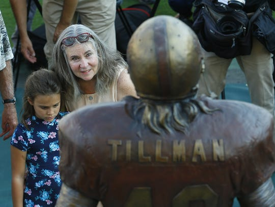 """Pat Tillman's  mother Mary """"Dannie"""" Tillman hugs her"""