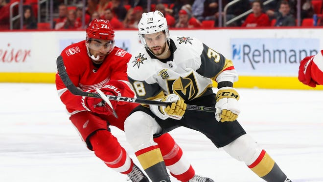 The Detroit Red Wings' Andreas Athanasiou and the  Vegas Golden Knights'  Tomas Hyka race for the puck during the third period Thursday night.