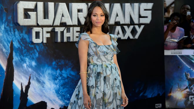 Zoe Saldana arrives for the European Premiere of Guardians Of The Galaxy at a central London cinema, Thursday, July 24, 2014.