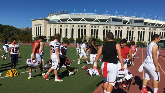 Archbishop Stepinac players walk off of the turf field
