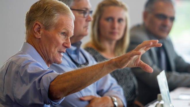 Senator Bill Nelson talks about water quality and releases from Lake Okeechobee with Southwest Florida mayors on Friday in Fort Myers.