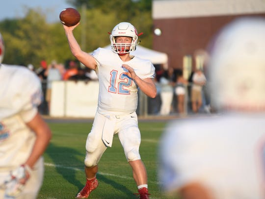 USJ's Cody Smith looks for a player to pass to at the