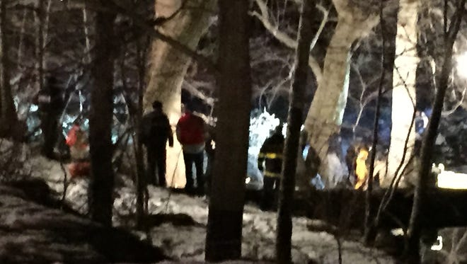 Authorities search Sunday night for a robbery suspect in the Ramapo River.
