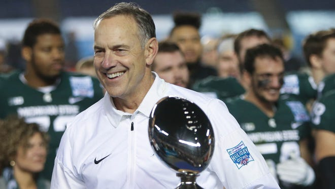 Mark Dantonio smiles after MSU's spanking of Washington State in the Holiday Bowl on Thursday in San Diego.