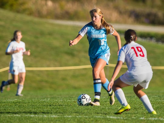 South Burlington's Annika Nielsen guides the ball past CVU's Sara Kelley in Hinesburg on Tuesday, October 11, 2016.