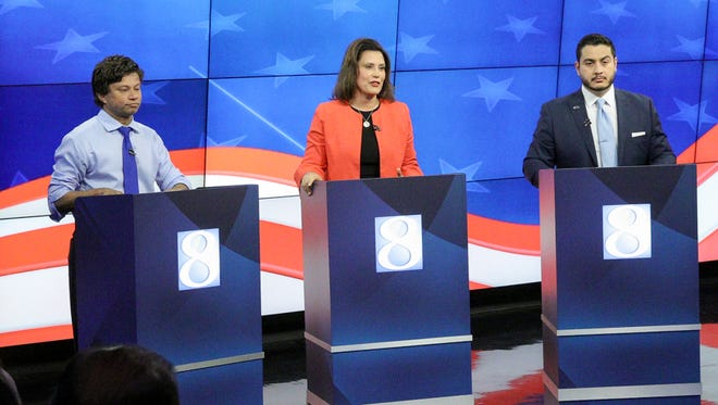(From left) Businessman Shri Thanedar, former state Senate minority leader Gretchen Whitmer, and Dr. Abdul El-Sayed participate in a televised gubernatorial debate in Grand Rapids on Wednesday.