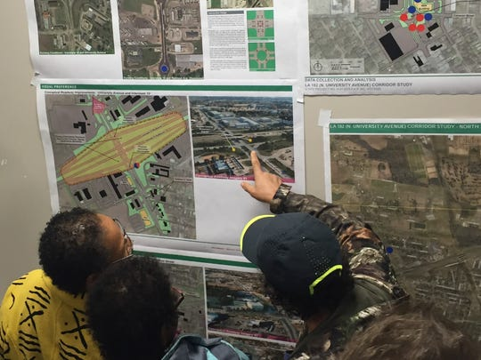 Residents review plans such as potential roundabouts along University Avenue in Lafayette, Louisiana, Jan. 29, 2018.