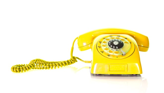 Antique yellow phone