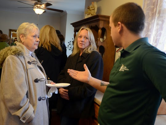 House Manager Garrett Willard talks to guests Carol Tobin and Yvonne Boone, both of Fort Gratiot, during an open house Monday, Dec. 7, at the Hunter Hospitality House on 10th Street in Port Huron.